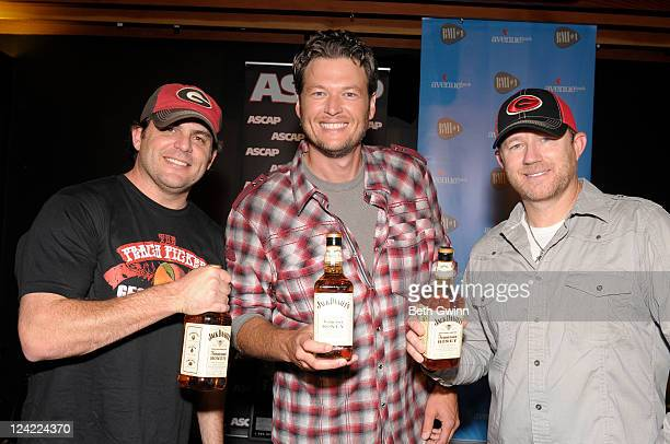 Rhett Akins Blake Shelton and Ben Hayslip pose with Jack Daniels Honey and attends the ASCAP party for Honey Bee at Warner Bros Music on September 8...