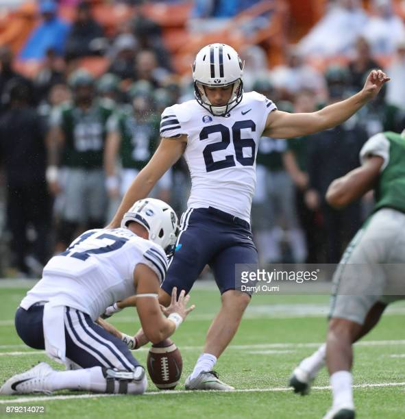 Rhett Almond of the BYU Cougars kicks an extra point during the first quarter of the game against the Hawaii Rainbow Warriors at Aloha Stadium on...