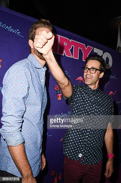 Rhett and Link arrive at the premiere of Lionsgate's 'Dirty 30' at ArcLight Hollywood on September 20 2016 in Hollywood California