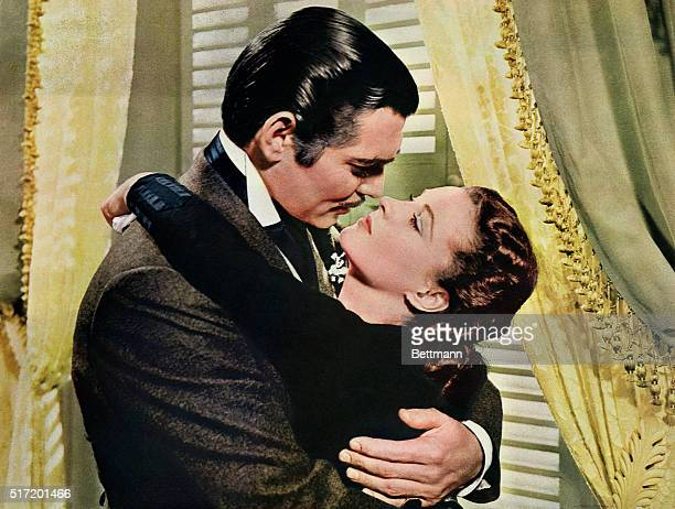 Rhett Butler embraces Scarlett O'Hara in a famous scene from the 1939 epic film Gone with the Wind
