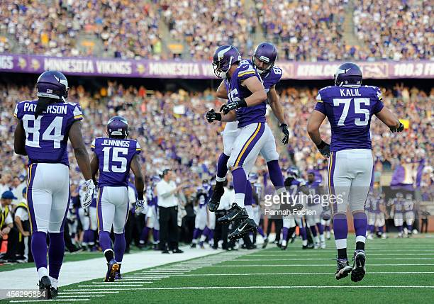 Rhett Ellison and Bear Pascoe of the Minnesota Vikings celebrate after Ellison completed a two-point conversion against the Atlanta Falcons during...