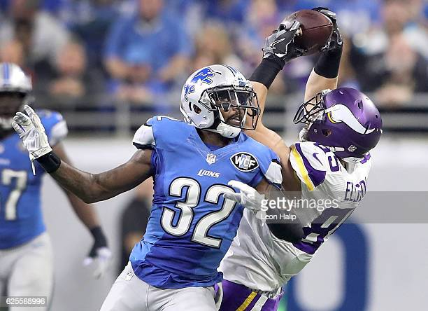 Rhett Ellison of the Minnesota Viking makes a catch over Tavon Wilson of the Detroit Lions during second quarter sat Ford Field on November 24 2016...