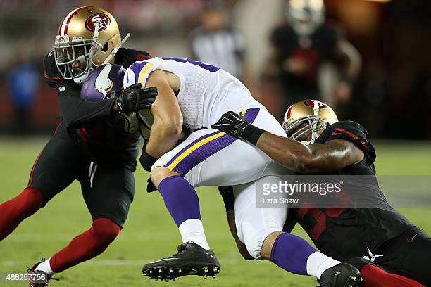 Rhett Ellison of the Minnesota Vikings is tackled by Ahmad Brooks and Kenneth Acker of the San Francisco 49ers during their NFL game at Levi's...