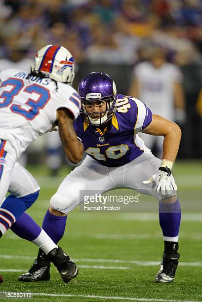 Rhett Ellison of the Minnesota Vikings lines up against Ron Brooks of the Buffalo Bills during the game on August 17 2012 at Mall of America Field at...