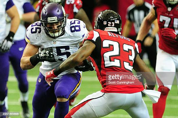 Rhett Ellison of the Minnesota Vikings runs the ball against Robert Alford of the Atlanta Falcons during the first half at the Georgia Dome on...