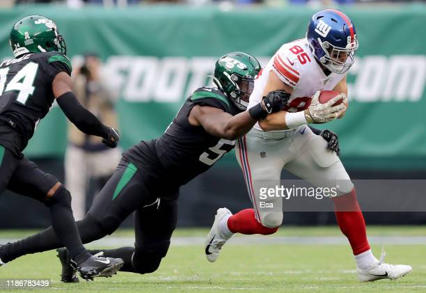Rhett Ellison of the New York Giants carries the ball as Brandon Copeland of the New York Jets defends at MetLife Stadium on November 10, 2019 in...