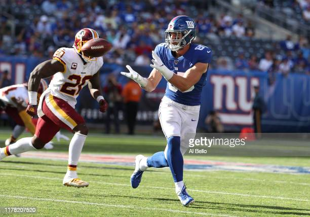 Rhett Ellison of the New York Giants catches the ball against Landon Collins of the Washington Redskins during their game at MetLife Stadium on...