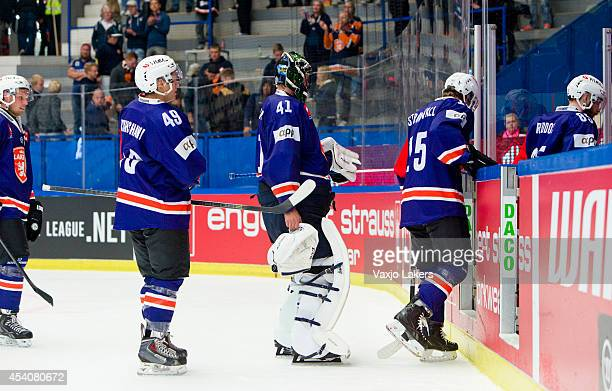 Rhett Rakhshani of Vaxjo Lakers and team mates Christopher Nihlstorp and Malte Strömwall leave after loosing against Sparta Prague during the...