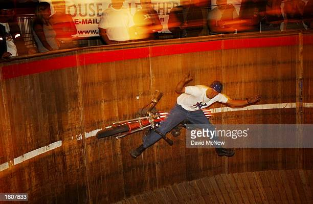 Rhett Rotten rides his motorcycle sidesaddle without using his hands or feet in the barrellike Wall of Death at the Full Throttle Saloon during the...