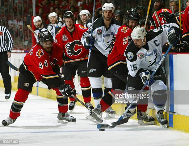 Rhett Warrener of the Calgary Flames goes for the stick check against Dave Andreychuk of the Tampa Bay Lightning in Game four of the NHL Stanley Cup...