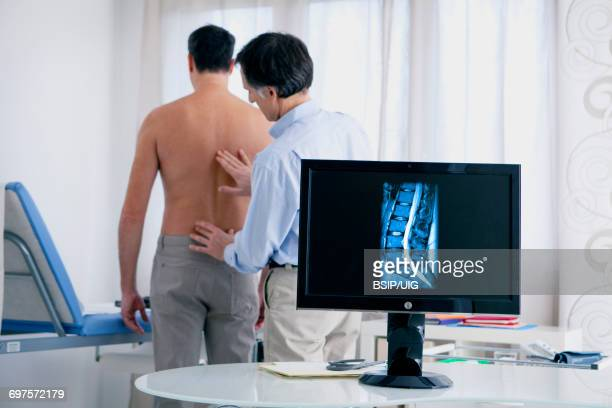 rheumatology consultation man - herniated disc stock photos and pictures