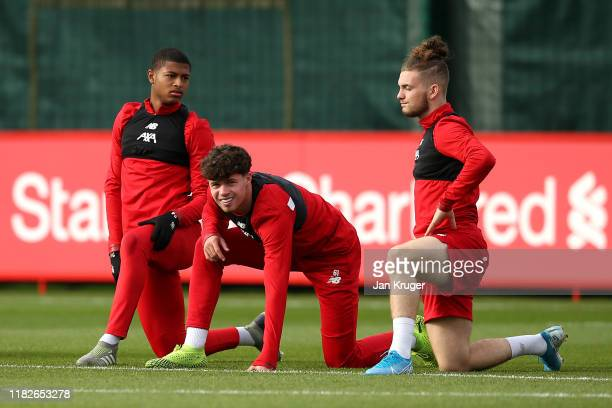 Rhian Brewster Neco Williams and Harvey Elliott warm up during a Liverpool training session ahead of the Champions League group E match against KRC...