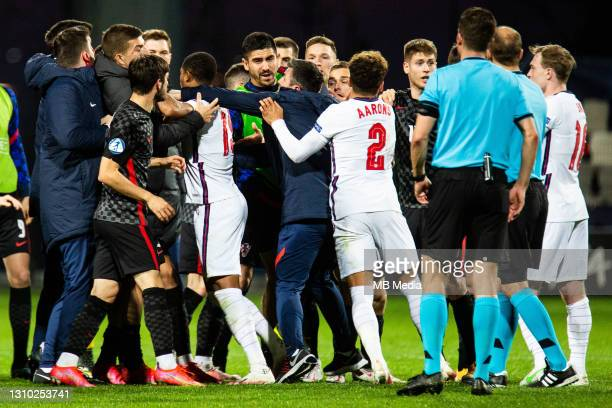 Rhian Brewster of England and Max Aarons of England roughing with Croatian national team after the 2021 UEFA European Under-21 Championship Group D...