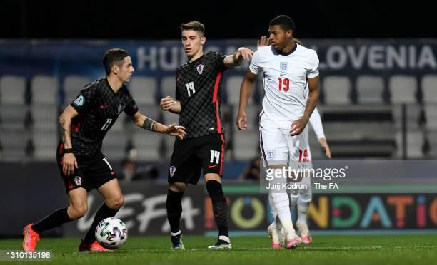 Rhian Brewster of England battles for possession with Domagoj Bradaric and Dario Vizinger of Croatia during the 2021 UEFA European Under-21...