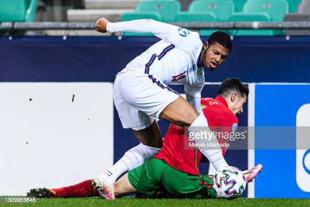 Rhian Brewster of England battles for the ball with Filipe Soares of Portugal during the 2021 UEFA European Under-21 Championship Group D match...