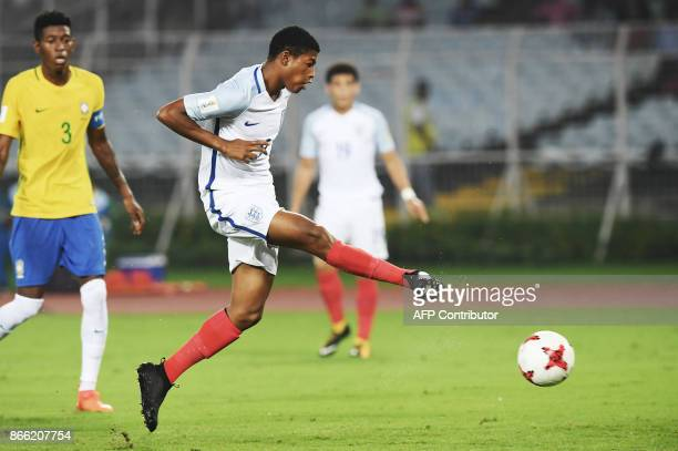 Rhian Brewster of England scores a goal against Brazil during the semifinal football match in the FIFA U17 World Cup at the Vivekananda Yuba Bharati...