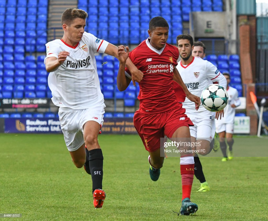 Rhian Brewster of Liverpool and Enrique Rios Vega of Sevilla in action during the UEFA Champions League group E match between Liverpool FC and Sevilla FC at Prenton Park on September 13, 2017 in Birkenhead, United Kingdom.