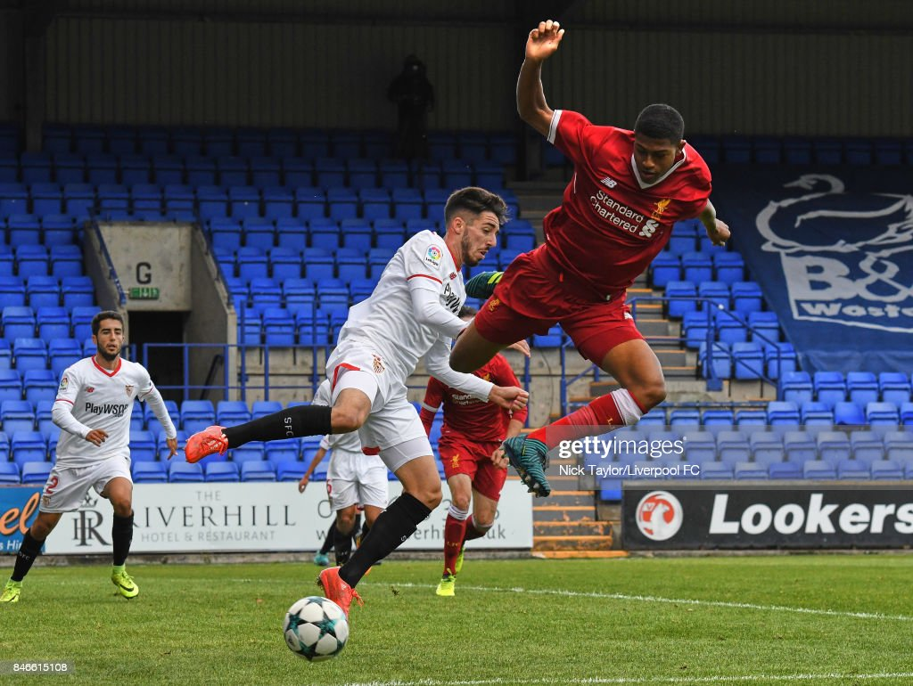 Rhian Brewster of Liverpool and Francisco Carmona Garcia of Sevilla in action during the UEFA Champions League group E match between Liverpool FC and Sevilla FC at Prenton Park on September 13, 2017 in Birkenhead, United Kingdom.