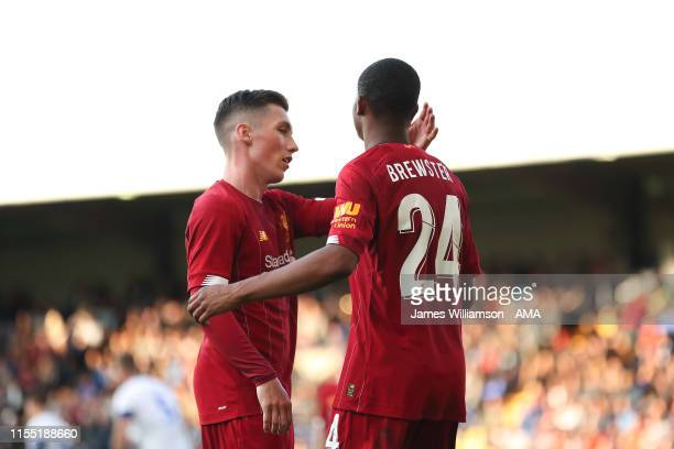 Rhian Brewster of Liverpool celebrates after scoring a goal to make it 0-3 with Harry Wilson during the Pre-Season Friendly match between Tranmere...