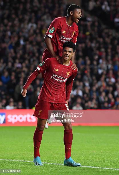 Rhian Brewster of Liverpool celebrates by jumping on KiJana Hoever of Liverpool after KiJana Hoever scores his sides second goal during the Carabao...