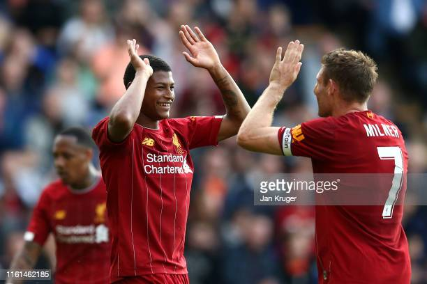 Rhian Brewster of Liverpool celebrates his goal with James Milner of Liverpool during the Pre-Season Friendly match between Tranmere Rovers and...