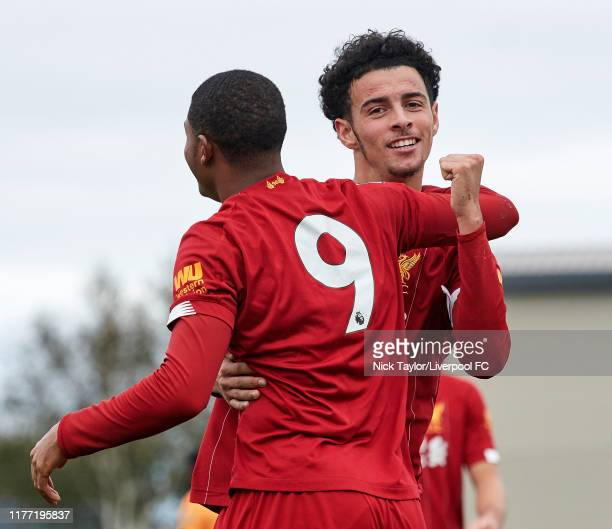 Rhian Brewster of Liverpool celebrates scoring the opening goal with Curtis Jones during the PL2 game at The Kirkby Academy on October 20 2019 in...