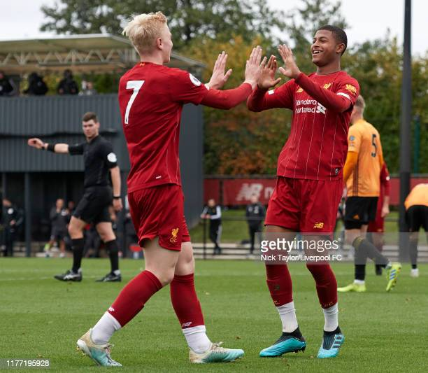 Rhian Brewster of Liverpool celebrates scoring the third goal for Liverpool with Luis Longstaff during the PL2 game at The Kirkby Academy on October...