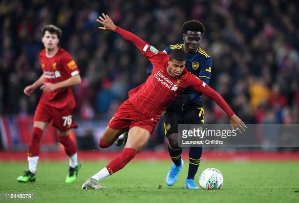 Rhian Brewster of Liverpool is challenged by Bukayo Saka of Arsenal during the Carabao Cup Round of 16 match between Liverpool and Arsenal at Anfield...