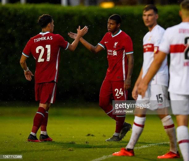Rhian Brewster of Liverpool is congratulated by Kostas Tsimikas of Liverpool after the third goal during the pre-season friendly match between...