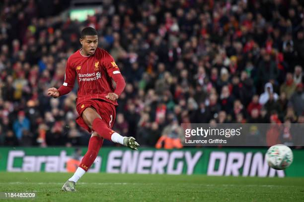 Rhian Brewster of Liverpool scores his sides third penalty during the penalty shoot out during the Carabao Cup Round of 16 match between Liverpool...
