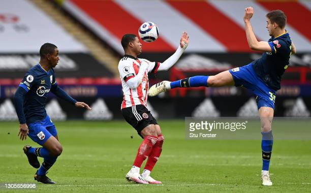 Rhian Brewster of Sheffield United and Jan Bednarek of Southampton battle for possession during the Premier League match between Sheffield United and...