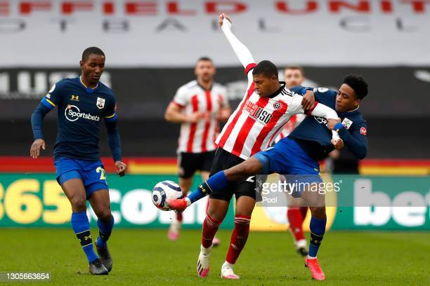 Rhian Brewster of Sheffield United and Kyle Walker-Peters of Southampton battle for the ball during the Premier League match between Sheffield United...