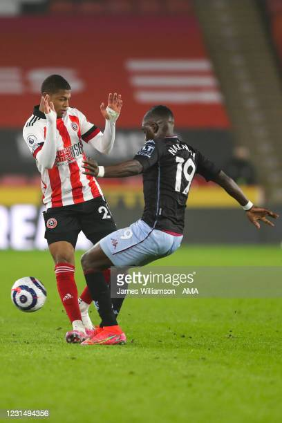 Rhian Brewster of Sheffield United and Marvelous Nakamba of Aston Villa during the Premier League match between Sheffield United and Aston Villa at...