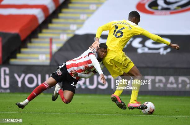 Rhian Brewster of Sheffield United is challenged by Tosin Adarabioyo of Fulham during the Premier League match between Sheffield United and Fulham at...