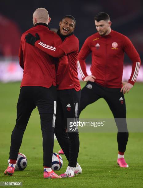 Rhian Brewster of Sheffield United reacts as he warms up with team mates prior to the Premier League match between Sheffield United and Liverpool at...