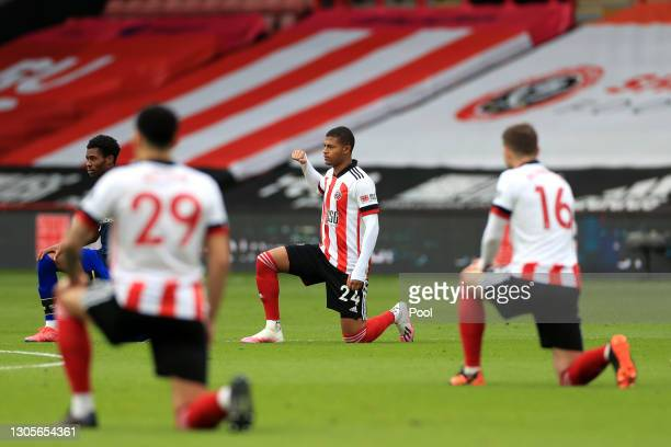 Rhian Brewster of Sheffield United takes a knee in support of the Black Lives Matter Movement prior to the Premier League match between Sheffield...
