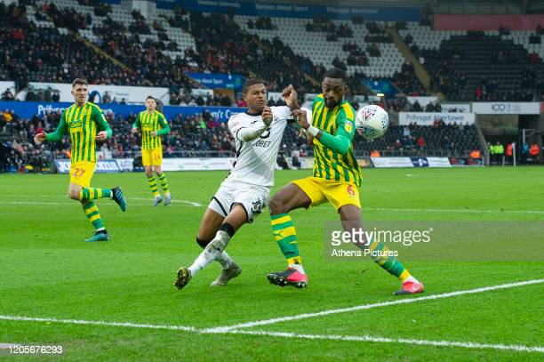 Rhian Brewster of Swansea City battles with Semi Ajayi of West Bromwich Albion during the Sky Bet Championship match between Swansea City and West...