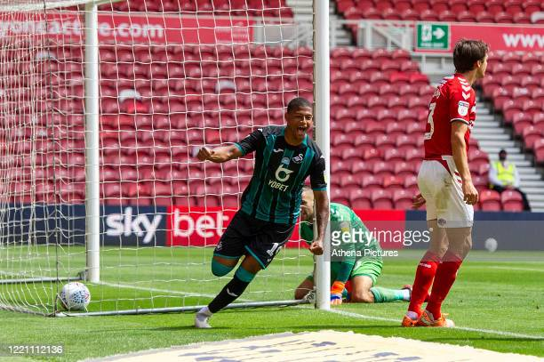Rhian Brewster of Swansea City celebrates scoring the opening goal during the Sky Bet Championship match between Middlesbrough and Swansea City at...