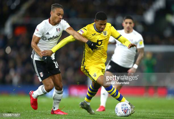 Rhian Brewster of Swansea City is challenged by Bobby DecordovaReid of Fulham during the Sky Bet Championship match between Fulham and Swansea City...