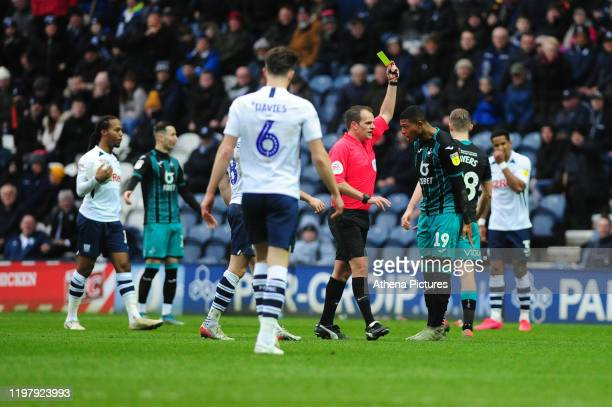 Rhian Brewster of Swansea City is given a yellow card during the Sky Bet Championship match between Preston North End and Swansea City at the...