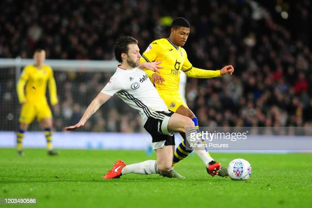 Rhian Brewster of Swansea City is tackled by Harry Arter of Fulham during the Sky Bet Championship match between Fulham and Swansea City at Craven...