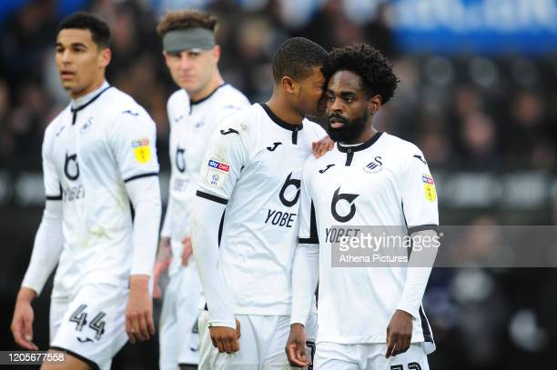Rhian Brewster speaks to team mate Nathan Dyer of Swansea City during the Sky Bet Championship match between Swansea City and West Bromwich Albion at...