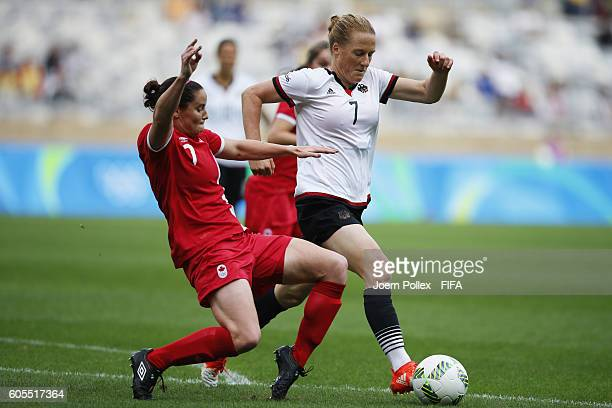 Rhian Wilkinson of Canada and Melanie Behringer of Germany compete for the ball during the Women's Semi Final match between Canada and Germany on Day...