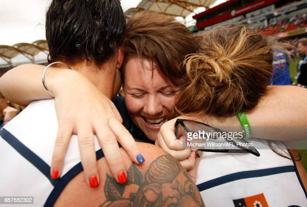 Rhiannon Metcalfe Bec Goddard Senior Coach of the Crows and Chelsea Randall of the Crows celebrate during the 2017 AFLW Grand Final match between the...