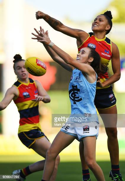 Rhiannon Metcalfe of the Adelaide Crows spoils Sophie Li of Carlton during the round five AFLW match between the Adelaide Crows and the Carlton Blues...
