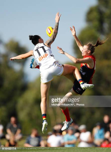 Rhiannon Metcalfe of the Crows and Erin Hoare of the Demons compete in a ruck contest during the 2018 AFLW Round 02 match between the Melbourne...