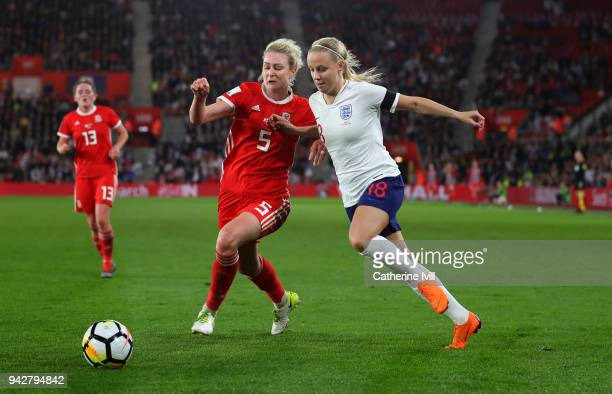 Rhiannon Roberts of Wales battles with Beth Mead during the Women's World Cup Qualifier between England and Wales at St Mary's Stadium on April 6...