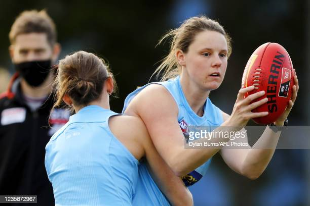 Rhiannon Watt of the Saints is tackled during the St Kilda training session at RSEA Park on October 14, 2021 in Melbourne, Australia.