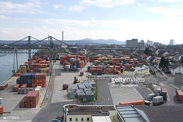 Rhine harbor and skyline Bonn with container storage.