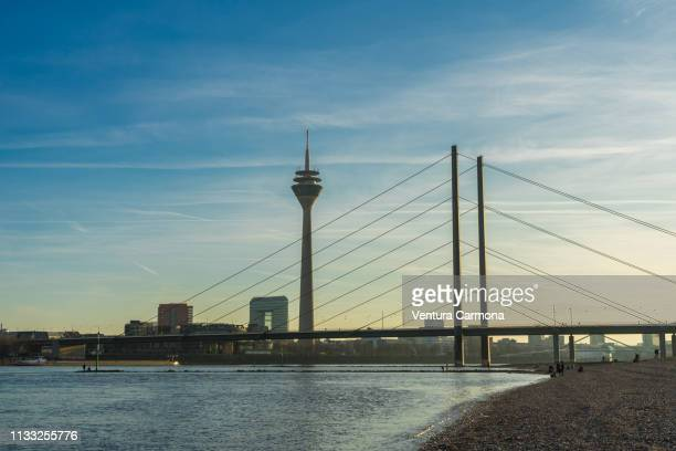 rhine river bank in düsseldorf, germany - uferviertel stock pictures, royalty-free photos & images